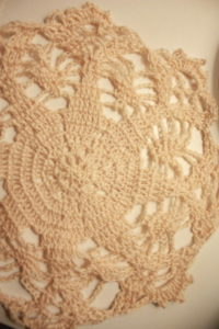 A beige doily on a creme background